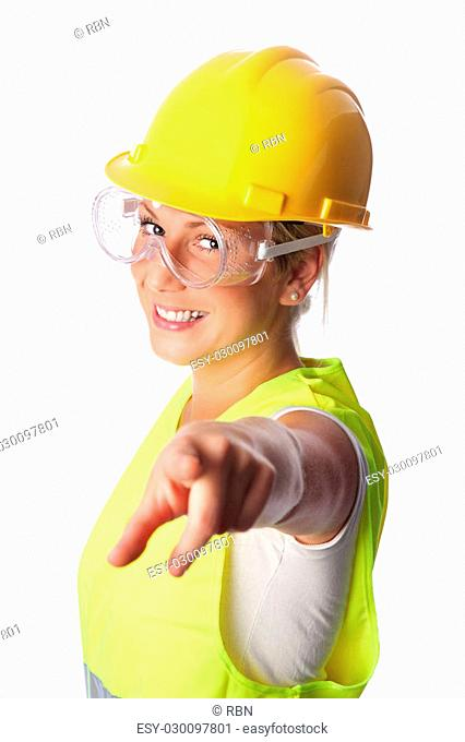 Young attractive female construction worker wearing a reflective vest and hard hat. White background