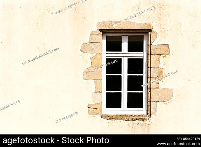 Old wooden window in french house, vintage background