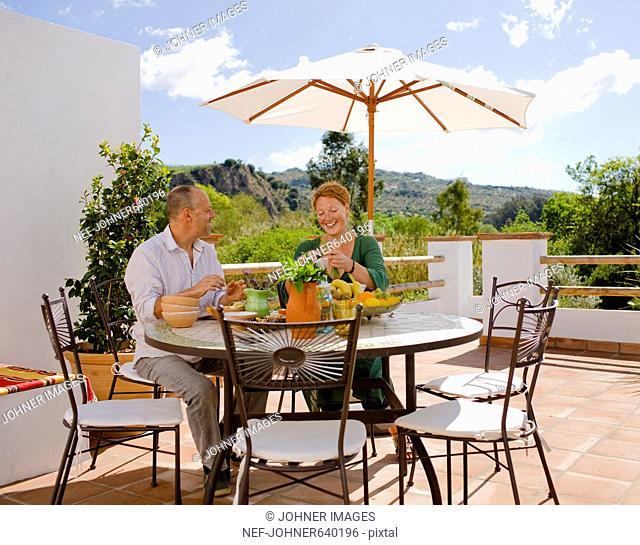 A Scandinavian couple having breakfast outside, Spain