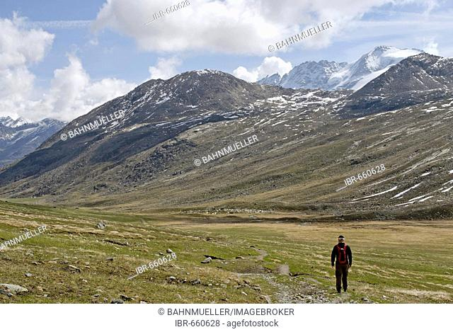 Gran Paradiso National Park between Piemonte Piedmont and Aosta valley Italy Garian Alps hikers at the old path to the Val Salvarenche at the high plateau Plan...