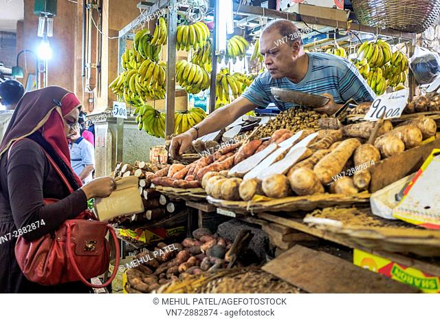 Local lady shopping for fresh produce at Central Market, Port Luis, Mauritius, Africa