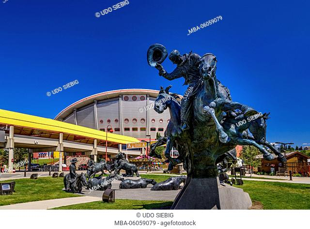 Canada, Alberta, Bow River Valley, Calgary, Stampede Park, cowboy sculpture with Saddledome