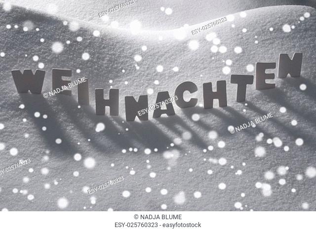 White Wooden Letters Building German Text Weihnachten Means Christmas. Snow And Snowy Scenery With Snowfalkes. Christmas Atmosphere