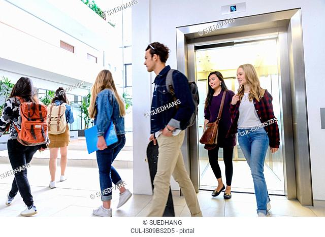 University students exiting elevator in campus
