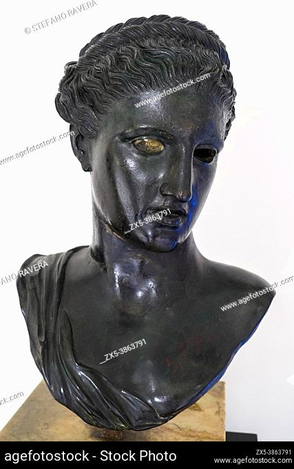 Bronze bust of Berenice / Artemis (the Greek goddess of the hunt, the wilderness, wild animals, the Moon, and chastity. The goddess Diana is her Roman...