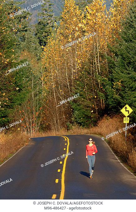 Female jogger on forest road