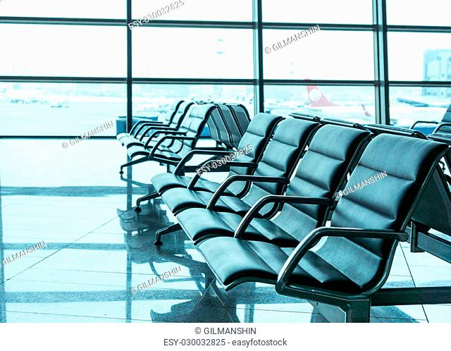 airport waiting area, seats and outside the window scene