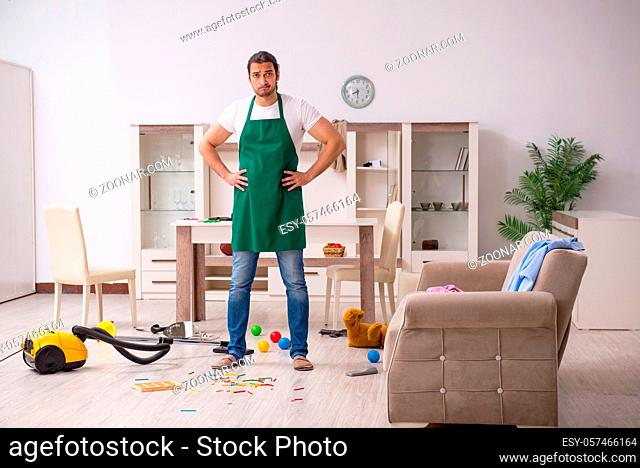 Young contractor cleaning the flat after kids' party