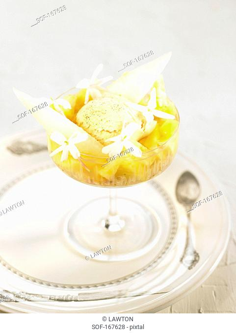 Vanilla ice cream,pineapple,melon and jasmin flower dessert