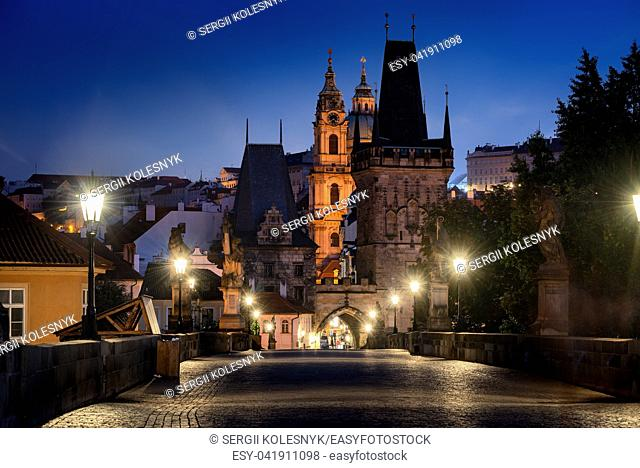 Illuminated ancient towers on Charles bridge in Prague