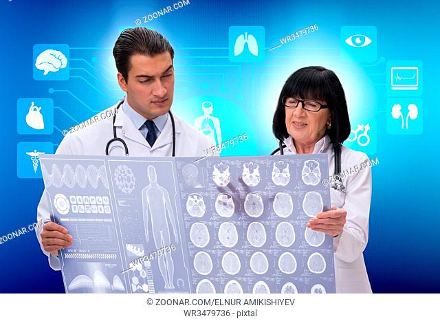 Two doctors discussing x-ray image in telemedicine concept