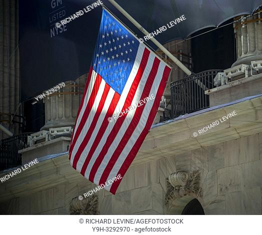An American flag hangs at half-staff outside the New York Stock Exchange in Lower Manhattan on Friday, January 11, 2019. Flags in the city were hanging at...