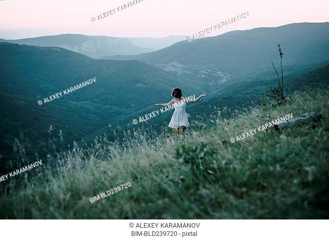 Carefree Caucasian woman walking on mountain