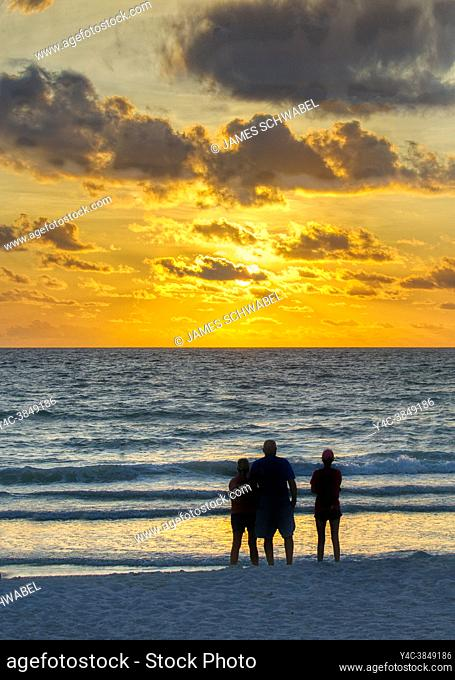 People watching sunset over the Gulf of Mexico from Nokomis Beach in Nokimis Florida USA