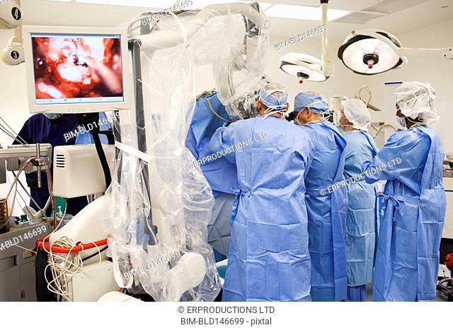Surgeons operating in operation room