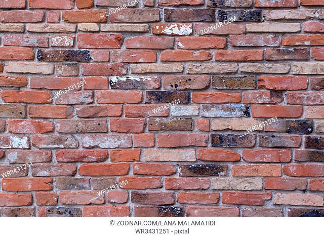 red brick wall texture grunge background, closeup