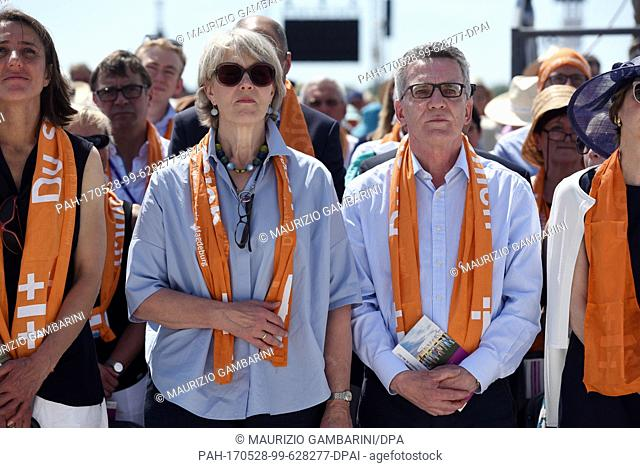 German Minister of the Interior Thomas de Maiziere (CDU,R) and his wife Martina de Maizière participate at the festival service of the German Protestant Church...