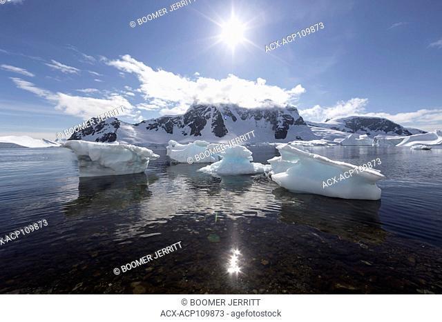 Small bergy bits remain grounded on the shore near Danco Island, Antarctic Peninsula