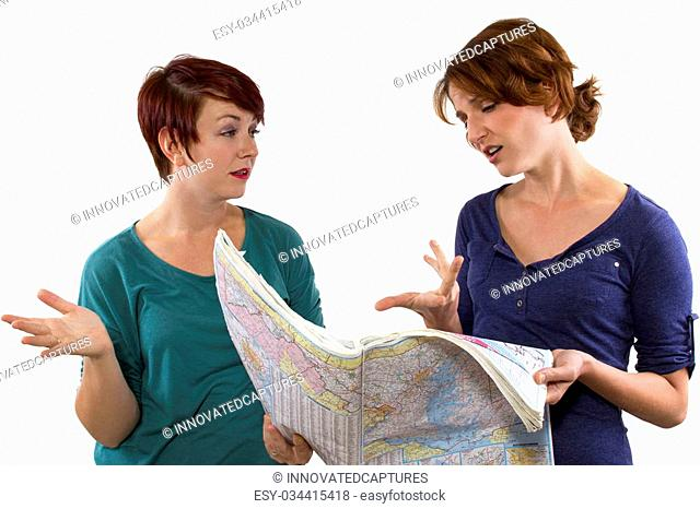 two young women are lost and looking at a map