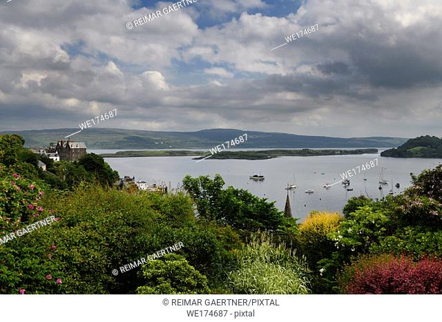 Hilltop garden view of Tobermory harbour Isle of Mull with Calve Island in the Sound of Mull Scotland UK