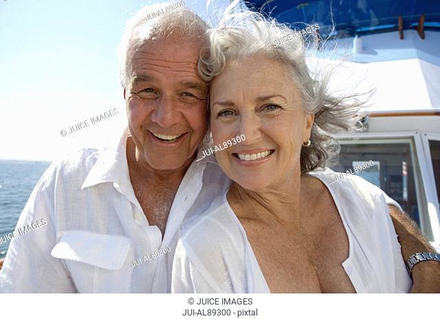 Senior couple hugging on boat