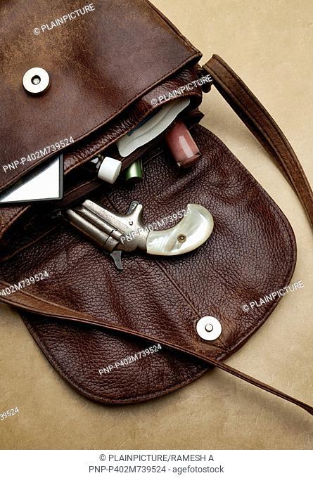 Still life handbag with revolver