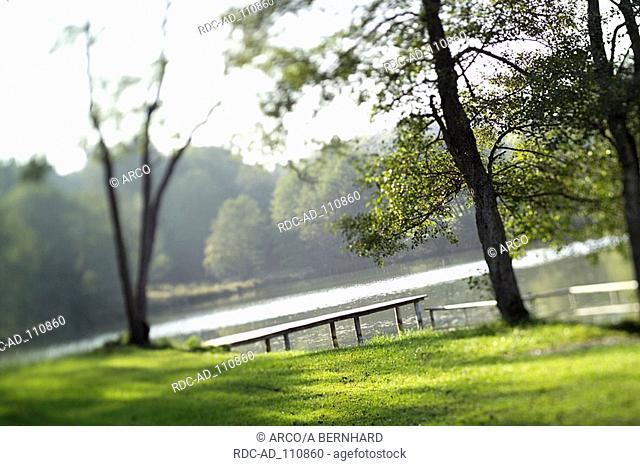 Lake with landing stage Irsee Bavaria Germany