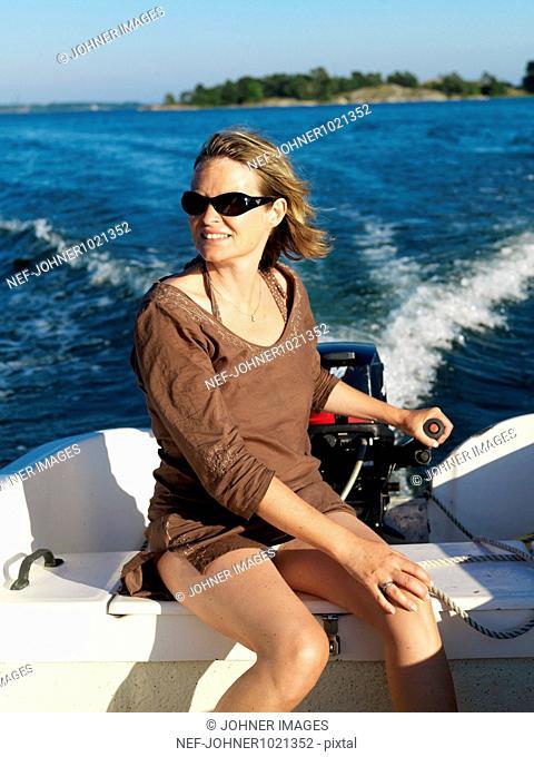 Woman sitting in motorboat
