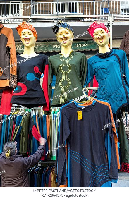 A cloths stall in the Rastro flea market around Lavapies and Embajadores in the centre of Madrid, Spain