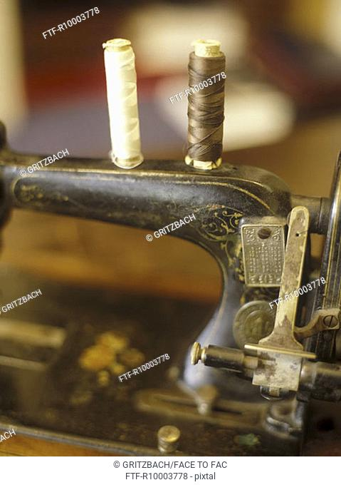 Old sewing machine with reels of thread