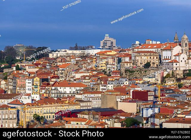Porto cityscape on Iberian Peninsula, second largest city in Portugal. View from Gaia city. Rosa Mota Pavilion on photo