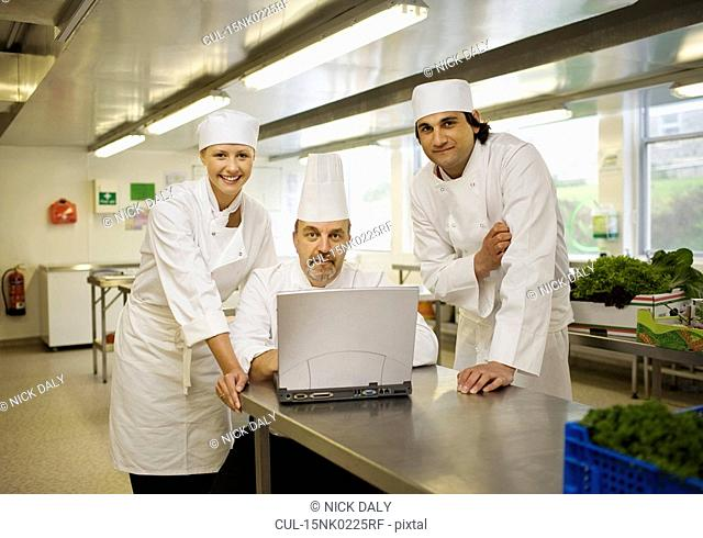 Three chefs looking at the camera