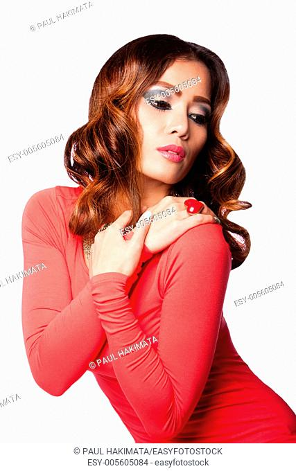 Beautiful attractive fashion model with wavy hairstyle, isolated