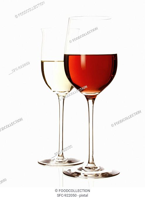 Red wine glass and white wine glass, half filled