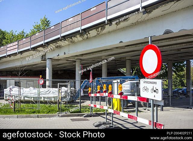 Repair work / renovation showing crumbling concrete, done at Mariakerkebrug, 60s bridge in the village Mariakerke near Ghent, East Flanders, Belgium