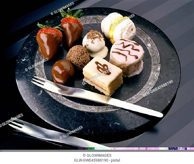 High angle view of chocolates and pastries on a plate