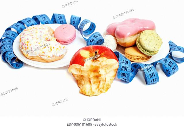 new diet concept, question sign in shape of measurment tape between red apple and donut plus candy isolated on white