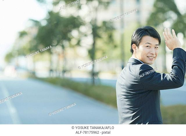 Japanese businessman going to work