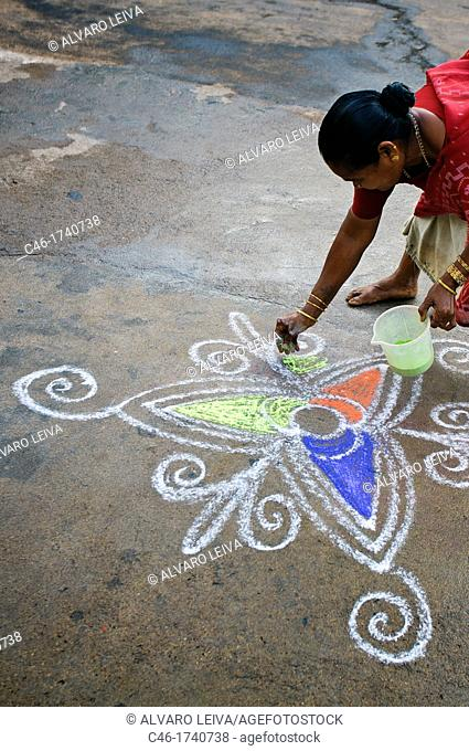 'Kolam' refers to decorative artwork drawn on the floor in front of houses and in front of temples  It is a time old cultural tradition of south Indian families
