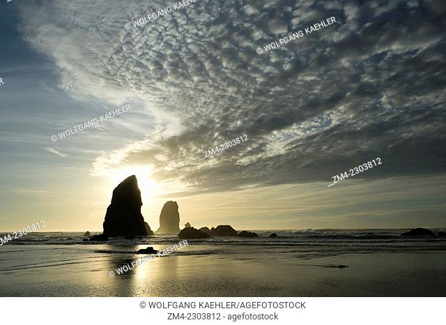 View of sea stacks at sunset at low tide from Cannon Beach on the Northern Oregon Coast, USA