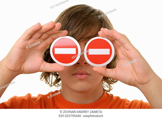 Teenager holds prohibiting signs before eyes
