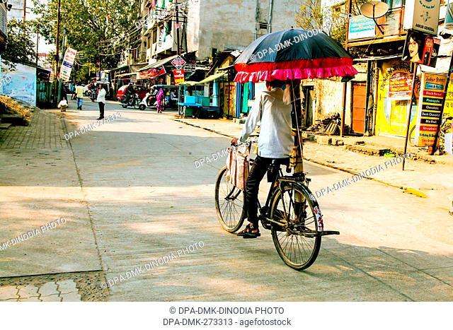 Bicycle with fixed umbrella , Nagpur, Maharashtra, India, Asia