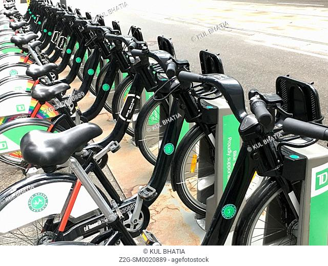 Bicycles for hire, one of several bike ranks located throughout Toronto, Ontario, Canada. Similar facilities can be seen in many big cities such as Montreal and...