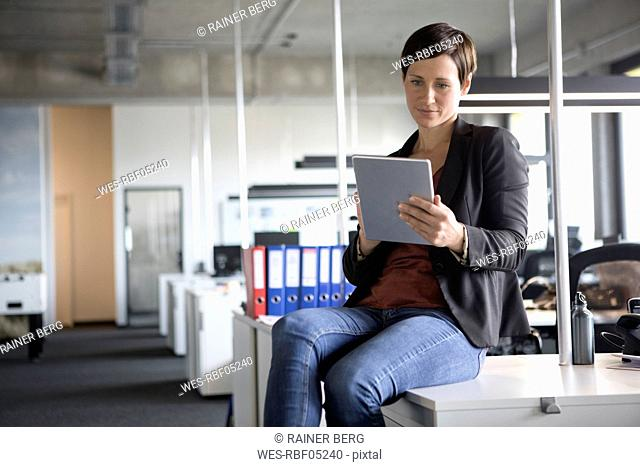 Businesswoman in office using tablet