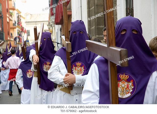 penitents during Holy Week procession in Seville