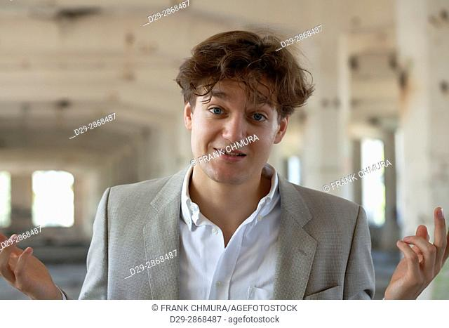 Young Man in Suit at Abandon Building