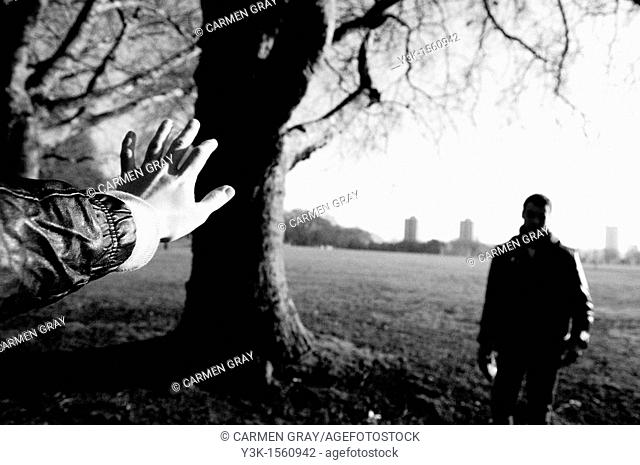 Couple getting separated in a park. London