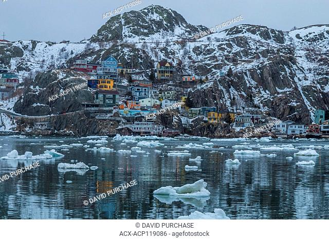 Looking over the narrows of St. John's harbour during winter, the quaint fishing village know as the Battery in the background. St