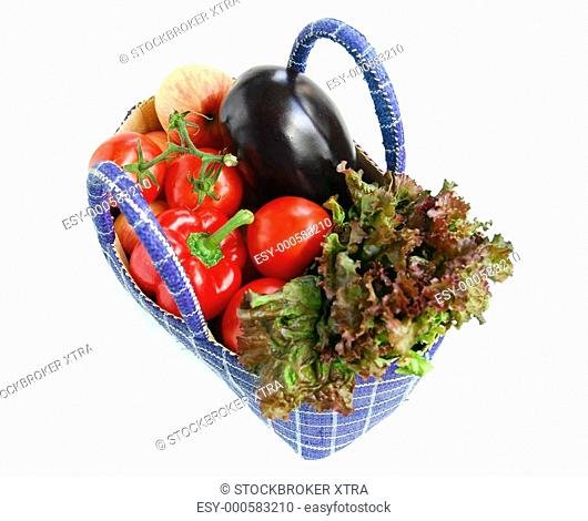Fresh vegetables and fruits in a basket isolated on white background