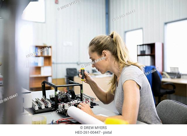 Female helicopter technician repairing module
